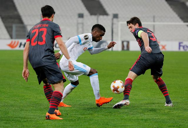 Soccer Football - Europa League Round of 32 First Leg - Olympique de Marseille vs S.C. Braga - Orange Velodrome, Marseille, France - February 15, 2018 Marseille's Bouna Sarr in action with Sporting Braga's Nikola Vukcevic and Joao Teixeira REUTERS/Jean-Paul Pelissier