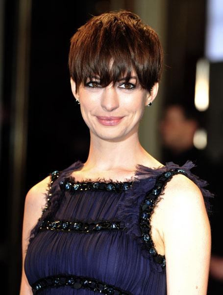 <b>Anne Hathaway at the Les Miserables premiere in Berlin, Feb 2013</b> <br><br>The star, who plays Fantine in the film, teamed her elfin style crop with smoky eyes and nude lips.<br><br>Image © Rex