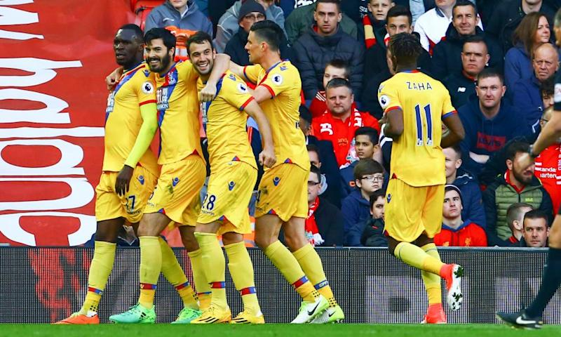 Christian Benteke, far left, celebrates Crystal Palace's winning goal against Liverpool at Anfield with his team-mates.
