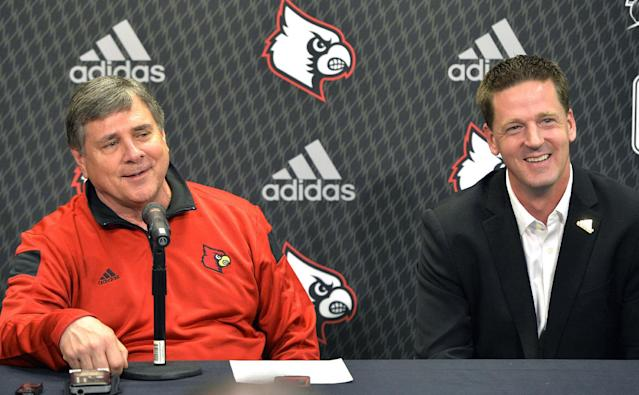 Louisville athletic director Tom Jurich, left, and Jim Murphy, NCAA sports marketing director with Adidas, attend a news conference Thursday, April 17, 2014, in Louisville, Ky. Louisville has announced the extension of its partnership with sports apparel maker Adidas, which will continue to outfit all 23 programs and include additional uniform combinations for the Cardinals' football team. (AP Photo/Timothy D. Easley)