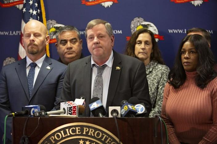 LOS ANGELES, CA - Wednesday, Dec. 4 Craig Lally, center, President of the Los Angeles Police Protective League, speaks during a press conference at the Los Angeles Police Protective League in downtown Los Angleles on Wednesday, Dec. 4, 2019. The Los Angeles Police Protective League Board of Directors will expressed their outrage over the allegation that an on-duty Los Angeles Police Department officer fondled a deceased female. If these allegations are found to be true and if there is any criminality involved, the Los Angeles Police Protective League will not defend the accused individual in any criminal proceedings. (Photographs by Gabriella Angotti-Jones/Los Angeles Times)