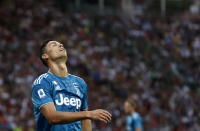 Juventus' Cristiano Ronaldo reacts after missing a chance to score during the Serie A soccer match between Parma and Juventus at the Tardini stadium, in Parma, Italy, Saturday, Aug. 24, 2019. (AP Photo/Antonio Calanni)