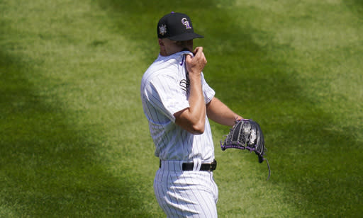 Colorado Rockies starting pitcher Ryan Castellani reacts after giving up a three-run home run to San Diego Padres' Eric Hosmer in the first inning of a baseball game Sunday, Aug. 30, 2020, in Denver.(AP Photo/David Zalubowski)