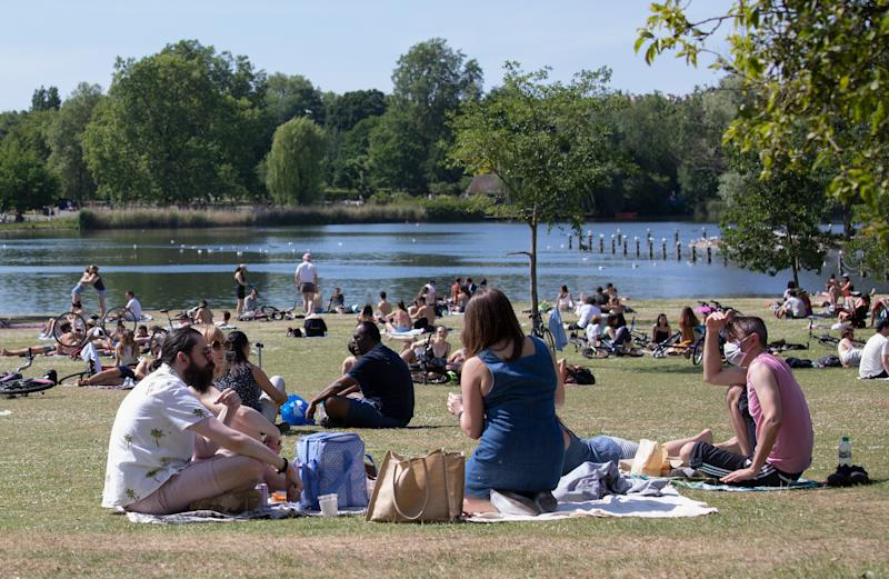 LONDON, ENGLAND - MAY 25: Members of the public sunbathing by the lake on a sunny Bank Holiday Monday in Regents Park on May 25, 2020 in London, England. The British government has started easing the lockdown it imposed two months ago to curb the spread of Covid-19, abandoning its 'stay at home' slogan in favour of a message to 'be alert', but UK countries have varied in their approaches to relaxing quarantine measures. (Photo by Jo Hale/Getty Images)