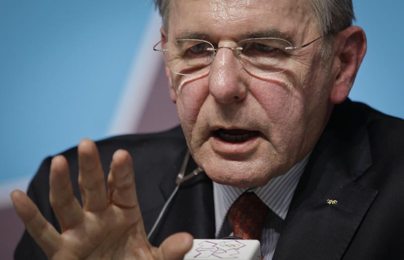 International Olympic Committee (IOC) President Jacques Rogges gestures to a reporter at a press conference for the media at the 2012 Summer Olympics, Saturday, July 21, 2012, in London. (AP Photo/Ben Curtis)
