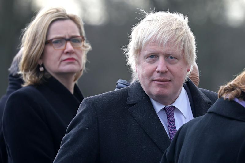 Britain's Foreign Secretary Boris Johnson (R) and Britain's Home Secretary Amber Rudd (L) attend a ceremony at the Royal Military Academy Sandhurst, west of London on January 18, 2018. French President Emmanuel Macron will take part in a Franco-British summit to discuss migration and Brexit. / AFP PHOTO / Ludovic MARIN (Photo credit should read LUDOVIC MARIN/AFP via Getty Images)