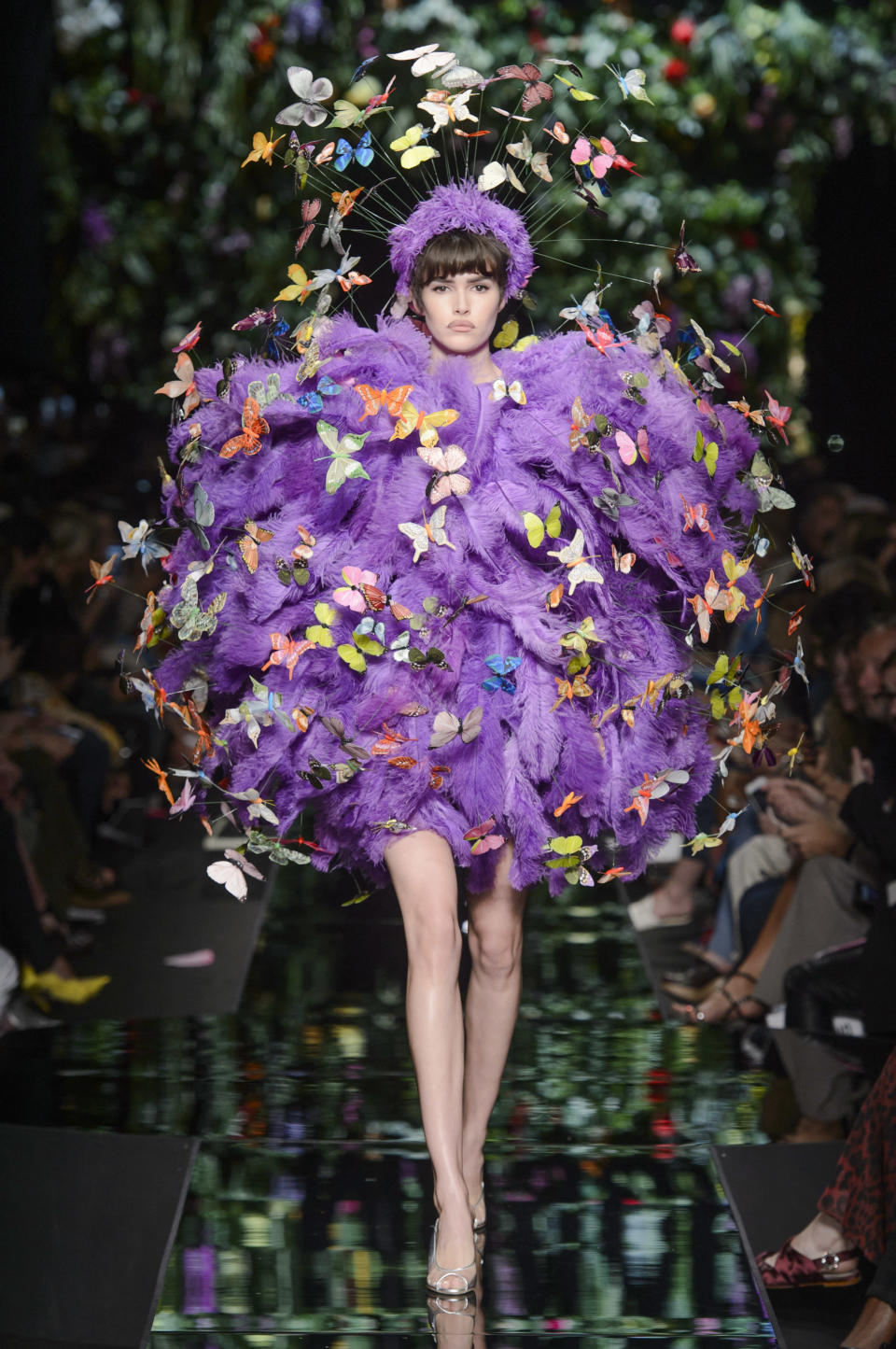 <p><i>Purple feather ball and butterfly appliqués from the SS18 Moschino collection. (Photo: ImaxTree) </i></p>