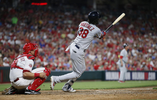 St. Louis Cardinals' Jose Martinez follows through on a three-run home run off Cincinnati Reds relief pitcher Jared Hughes during the sixth inning of a baseball game Friday, July 19, 2019, in Cincinnati. (AP Photo/Gary Landers)