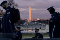 The Washington Monument and the National Mall are visible as members of the U.S. Air Force Honor Guard walk along the West Front of the U.S. Capitol at the site of the 59th Presidential Inauguration in Washington, Monday, Jan. 18, 2021. (AP Photo/Andrew Harnik)