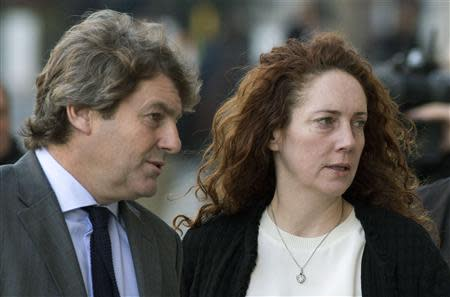 Former News International chief executive Rebekah Brooks and her husband Charlie arrives at the Old Bailey courthouse in London November 13, 2013. REUTERS/Neil Hall