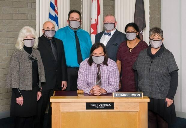 Prince George School District 57 Board Chair Trent Derrick, seated, and Vice-Chair Shuirose Valimohamed, second from right, have resigned citing systemic racism identified in a provincial Special Advisors Report released in late August 2021.  (courtesy School District no. 57 (Prince George) - image credit)