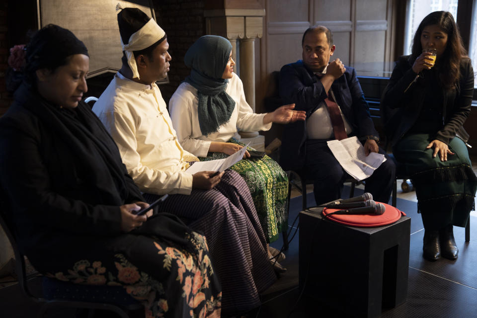 """Yasmin Ullah, center, and other representatives of the Rohingya community take their seats for """"Right of Reply"""" after two days of hearings at the International Court of Justice in The Hague, Netherlands, Wednesday, Dec. 11, 2019. Myanmar leader Aung San Suu Kyi defended Myanmar Wednesday and denied genocide accusations against the Rohingya Muslim minority in a case filed by Gambia at the ICJ, the United Nations' highest court. (AP Photo/Peter Dejong)"""