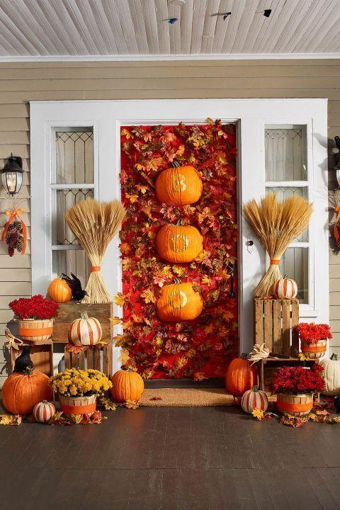 <p>This pretty display sets the tone for a harvest-style holiday. Stenciled, halved Fun-Kins anchor a cascade of maple leaf garlands. Add potted mums in apple baskets and sugar pumpkins striped with dried corn husks for a front door that will last into Thanksgiving.</p><p>1. Use a utility knife to halve two Fun-Kins lengthwise.</p><p>2. Print and cut out stencils for the word BOO.</p><p>3. Trace each letter onto a halved Fun-Kin with a pencil.</p><p>4. Use small paintbrush to apply gold enamel paint inside lines; let dry.</p><p>5. Hang on door with Command wire hooks.</p>