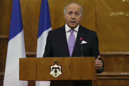 French Foreign Minister Fabius speaks during a joint news conference with his Jordanian counterpart Judeh at the Ministry of Foreign Affairs in Amman