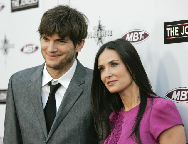 """Cast member Demi Moore (R) and her husband, actor Ashton Kutcher, arrive at the premiere of """"The Joneses"""" in Los Angeles."""