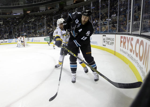 San Jose Sharks' Joe Thornton, right, passes as Nashville Predators' Roman Josi defends during the first period of an NHL hockey game Thursday, March 12, 2015, in San Jose, Calif. (AP Photo/Marcio Jose Sanchez)