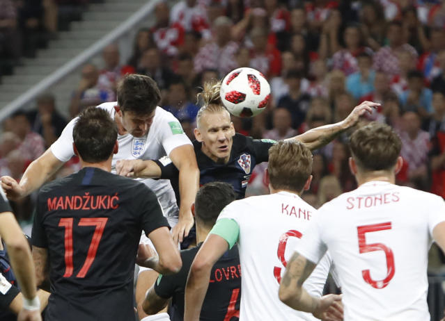 <p>Harry Maguire goes close from an England corner under pressure from Domagoj Vida </p>