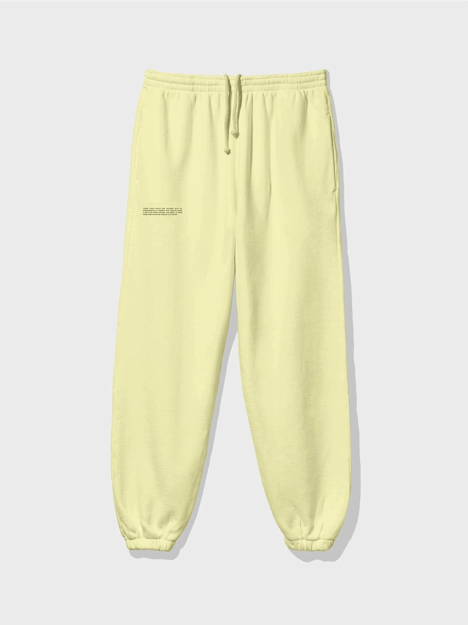 """<br><br><strong>Pangaia</strong> Lightweight Recycled Cotton Track Pants, $, available at <a href=""""https://thepangaia.com/products/lightweight-recycled-cotton-track-pants-hay-yellow"""" rel=""""nofollow noopener"""" target=""""_blank"""" data-ylk=""""slk:Pangaia"""" class=""""link rapid-noclick-resp"""">Pangaia</a>"""