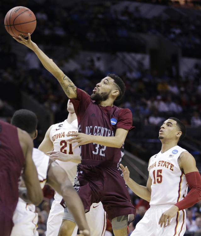 North Carolina Central guard Emanuel Chapman (32) best past Iowa State guard Matt Thomas (21) and guard Naz Long (15) to shoot during the first half of a second-round game in the NCAA college basketball tournament Friday, March 21, 2014, in San Antonio. (AP Photo/Eric Gay)