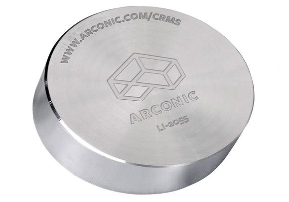 Metal cylinder with Arconic logo and information engraved on it.