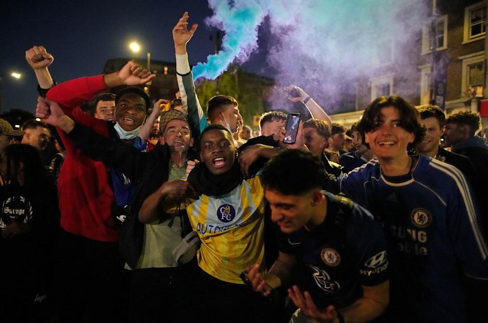 Supporters embraced in the streets of west London (AP)