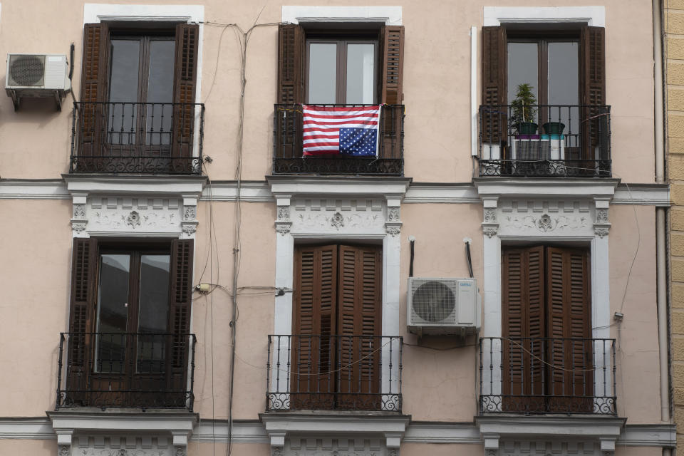 The U.S. flag placed on a balcony of an apartment is hung upside-down, a sign of distress, in Madrid, Spain on Nov. 6, 2020. (Paul White/AP)