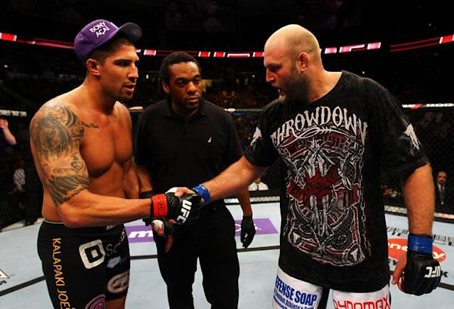 ATLANTA, GA - APRIL 21: Brendan Schaub (L) shakes hands with Ben Rothwell after Rothwell defeated him by TKO in their heavyweight bout for UFC 145 at Philips Arena on April 21, 2012 in Atlanta, Georgia.