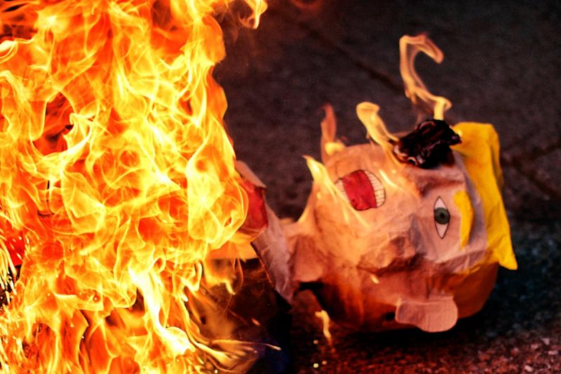 An effigy representing US President Donald Trump is burnt during a protest against his inauguration in Mexico City (AFP Photo/PEDRO PARDO)