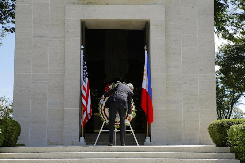 U.S. Secretary of State John Kerry lays a wreath at the Manila American Cemetery in Manila, Philippines, on Tuesday, Dec. 17, 2013. Kerry is in the Philippines to show American backing for its longtime ally and inspect typhoon recovery efforts. (AP Photo/Brian Snyder, Pool)