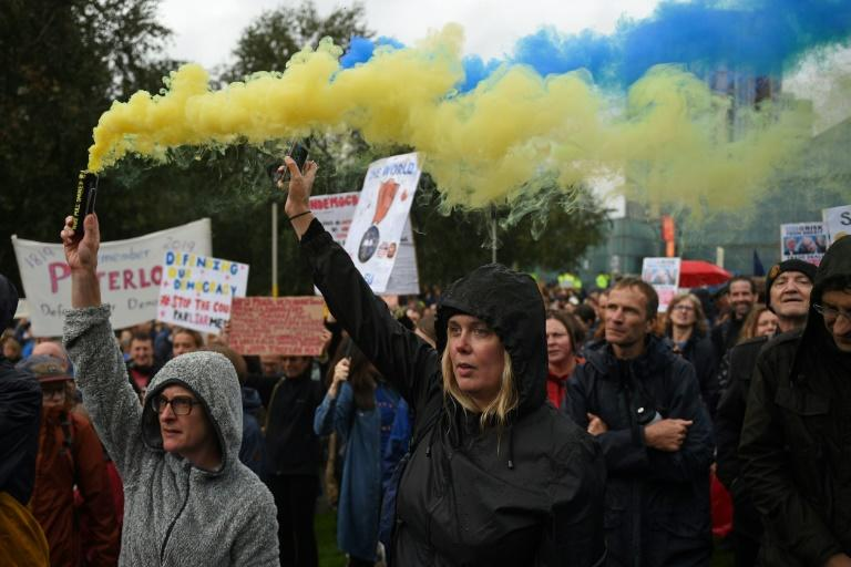Crowds gathered in Manchester, York and Newcastle in northern England, as well as London and Scottish capital Edinburgh and Belfast (AFP Photo/Oli SCARFF                          )