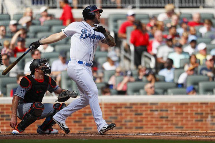 Atlanta Braves first baseman Matt Adams (18) hits a two run home run in the third inning of a baseball game against the Miami Marlins, Saturday, June 17, 2017, in Atlanta. (AP Photo/Todd Kirkland)