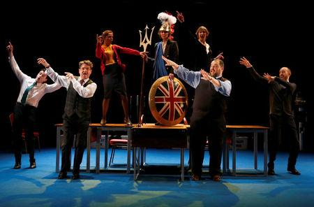 "The cast of the play ""My Country; a work in progress"" perform during a dress rehearsal at the National Theatre, in London"