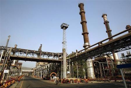 A worker rides a bicycle at Bharat Petroleum Corporation Ltd. refinery in Mumbai