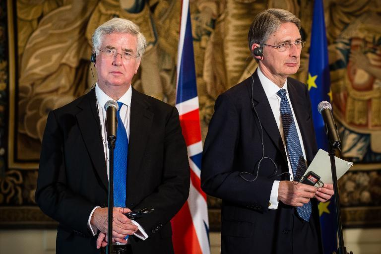 Britain's Defence Secretary Michael Fallon (L) and Foreign Secretary Philip Hammond address a joint press conferance with their Polish counterparts in Warsaw, Poland on July 28, 2014