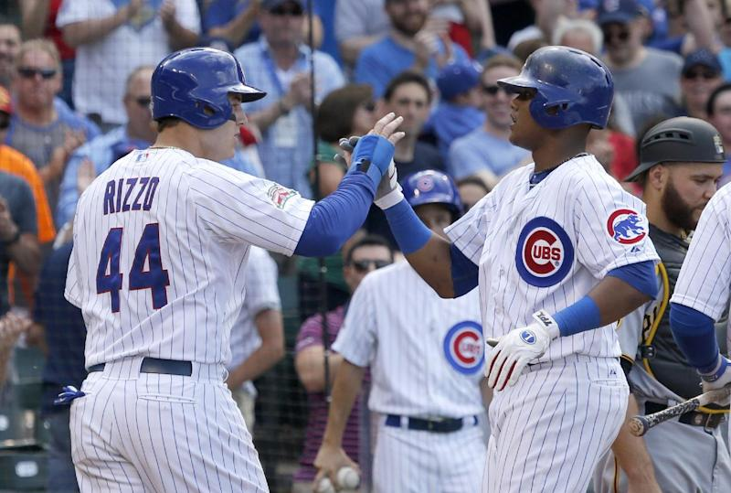 Chicago Cubs' Starlin Castro, right, celebrates his three-run home run off Pittsburgh Pirates starting pitcher Charlie Morton with teammate Anthony Rizzo during the third inning of a baseball game on Friday, June 20, 2014, in Chicago. Rizzo and Chris Coghlan also scored on the hit. (AP Photo/Charles Rex Arbogast)