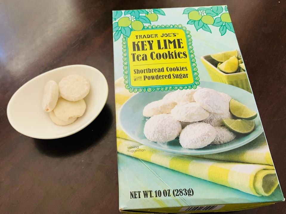 Trader Joe's key-lime tea cookies in a small white bowl next to the original teal and yellow box