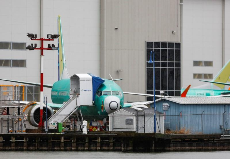 FILE PHOTO: A Boeing 737 Max aircraft is seen parked outside the company's production facility in Renton