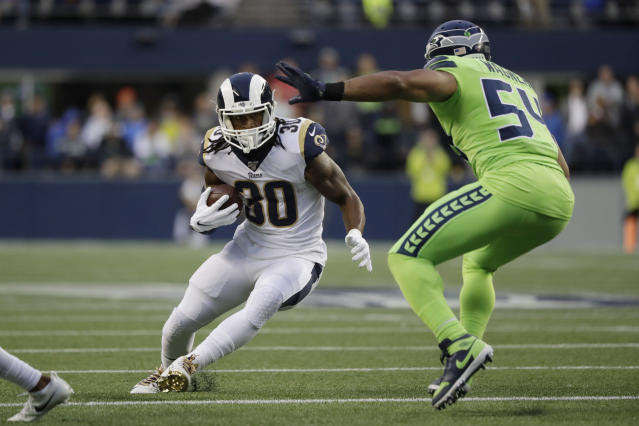 Los Angeles Rams running back Todd Gurley, left, squares off against Seattle Seahawks middle linebacker Bobby Wagner during the first half of an NFL football game Thursday, Oct. 3, 2019, in Seattle. (AP Photo/Elaine Thompson)