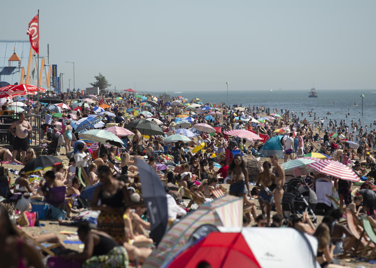 Large crowds gather at Southend beach as temperatures are set to rise to as high as 38C due to a huge heatwave hitting the UK