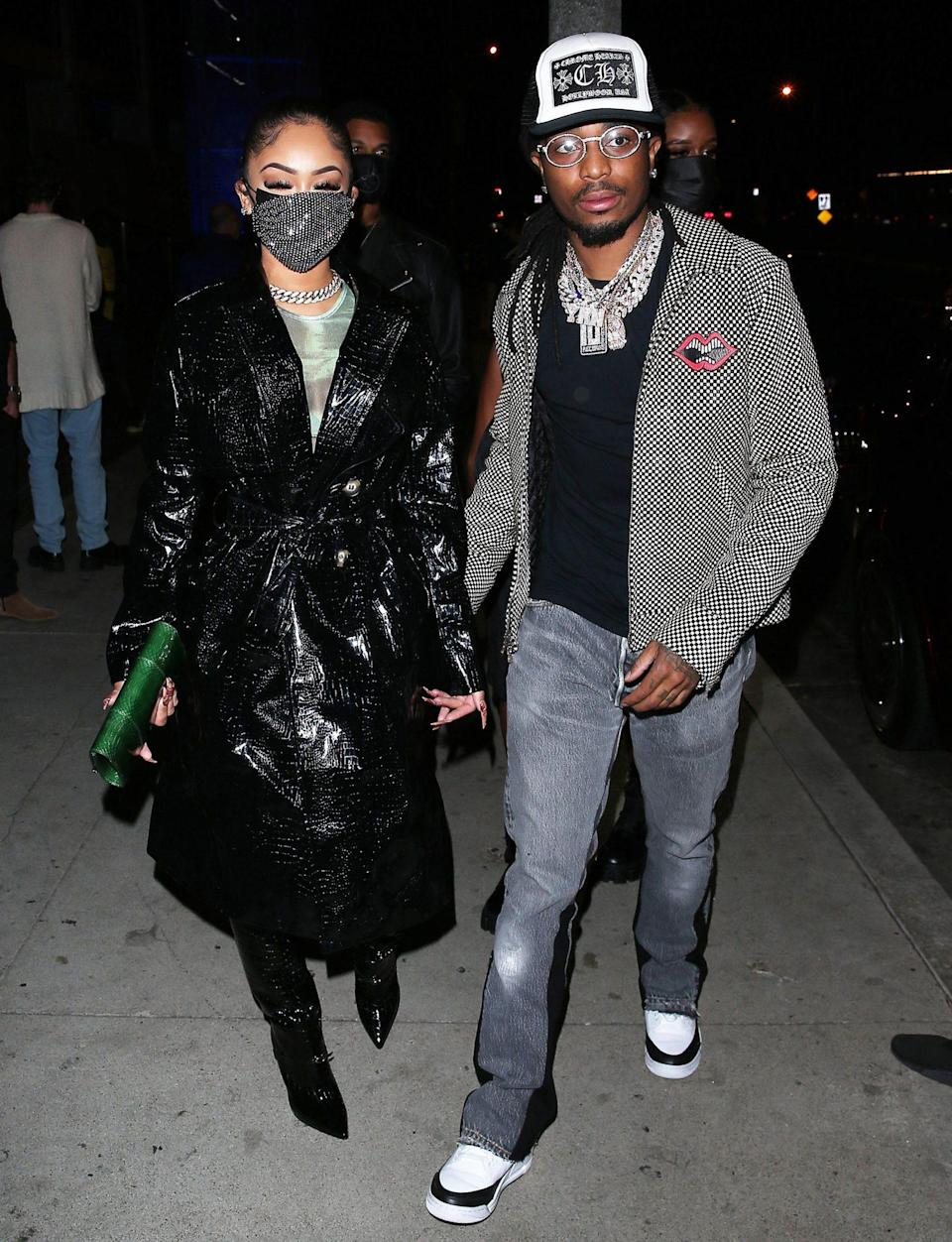 <p>Saweetie and Quavo hold hands as they arrive for dinner on Monday at BOA restaurant in Beverly Hills. </p>