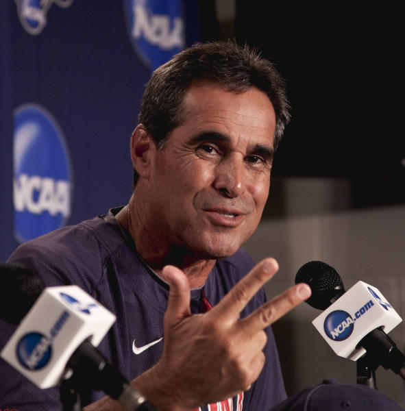 Arizona coach Andy Lopez gestures during a news conference Saturday, June 23, 2012, ahead of the NCAA College World Series baseball finals at TD Ameritrade Pard in Omaha, Neb. South Carolina and Arizona will play starting Sunday in the best-of-three games championship series. (AP Photo/Nati Harnik)