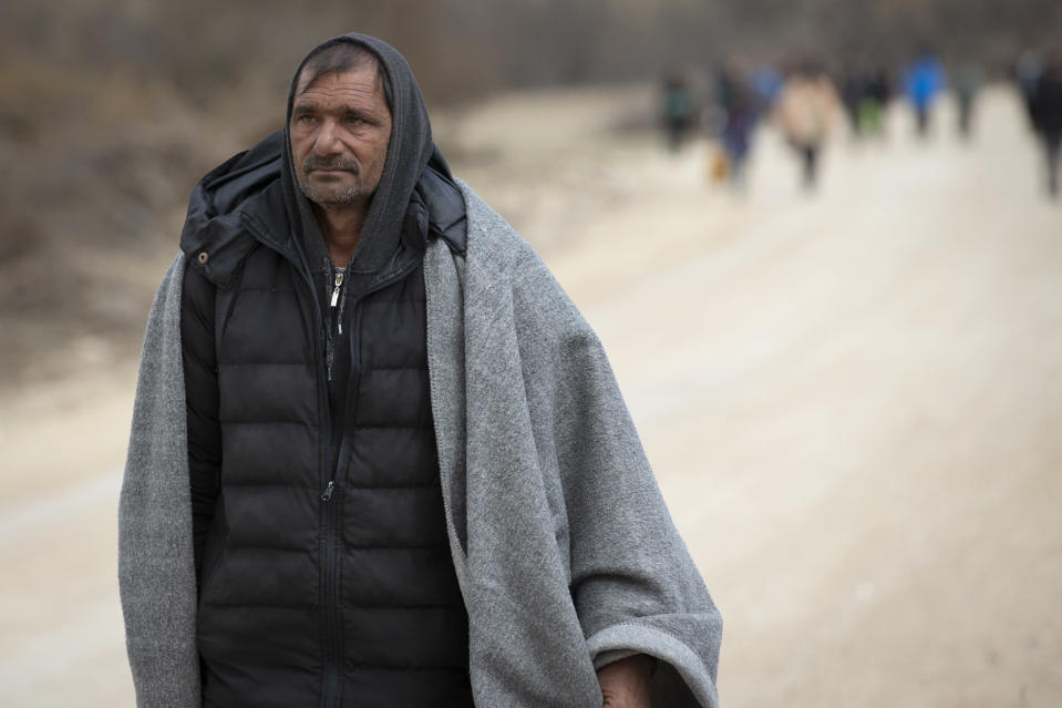 A migrant walks towards Croatian border in Lipa near Bihac, Western Bosnia, Wednesday, April 21, 2021. A senior U.N. migration official on Wednesday urged respect of international standards and an end to any abuse against migrants and refugees crossing borders while searching for a better future. The Chief of Staff of the International Organization for Migration, Eugenio Ambrosi, called on governments to correct any wrongdoing affecting people fleeing war and poverty. (AP Photo/Darko Bandic)