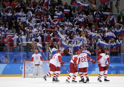 Russian athlete Ilya Kovalchuk (71) celebrates with his teammates after scoring a goal against the Czech Republic during the third period of the semifinal round of the men's hockey game at the 2018 Winter Olympics in Gangneung, South Korea, Friday, Feb. 23, 2018. Olympic Athletes from Russia won 3-0. (AP Photo/Julio Cortez)