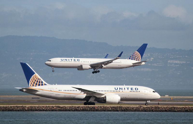 FILE PHOTO - A United Airlines 787 taxis as a United Airlines 767 lands at San Francisco International Airport, San Francisco