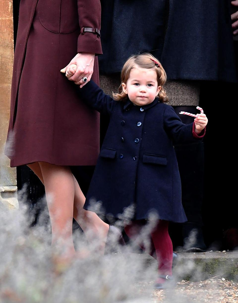 <p>Princess Charlotte carries a festive candy cane as she leaves a Christmas Day service with her family.</p>