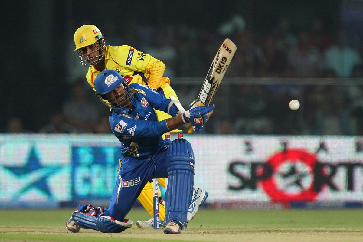 Dinesh Karthik tries an unorthodox shot but mis times it during the qualifier 1 match of the 2013 Pepsi Indian Premier League between The Chennai Superkings and the Mumbai Indians held at the Feroz Shah Kotla Stadium, Delhi on the 21st May 2013..Photo by Ron Gaunt-IPL-SPORTZPICS    ..Use of this image is subject to the terms and conditions as outlined by the BCCI. These terms can be found by following this link:..https://ec.yimg.com/ec?url=http%3a%2f%2fwww.sportzpics.co.za%2fimage%2fI0000SoRagM2cIEc&t=1495669192&sig=yyQg.v8lE.teMd6sQXYnVA--~C
