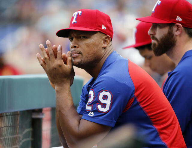 FILE - In this Aug. 14, 2018, file photo, Texas Rangers' Adrian Beltre (29) watches the team play the Arizona Diamondbacks during the first inning of a baseball game in Arlington, Texas. The Rangers are retiring Beltres number. The team revealed the plan Friday night, Jan. 25, at the end of its winter awards program. Beltre, who had 3,166 career hits, played the last eight of his 21 big league seasons for Texas before announcing his retirement in November. The third basemans No. 29 will be the fourth number retired by the team, during a ceremony sometime in June. (AP Photo/Michael Ainsworth, File)