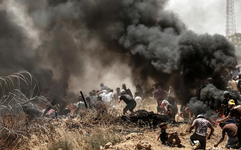Palestinians clash with with Israeli forces near the border between the Gaza Strip and Israel