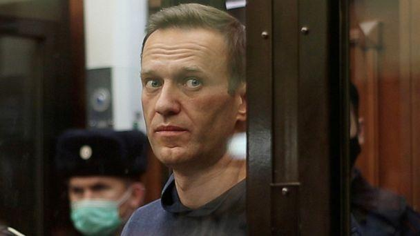 PHOTO: A still image taken from video footage shows Russian opposition leader Alexei Navalny inside a defendant dock during the announcement of a court verdict in Moscow, Feb. 2, 2021. (Simonovsky District Court via Reuters)