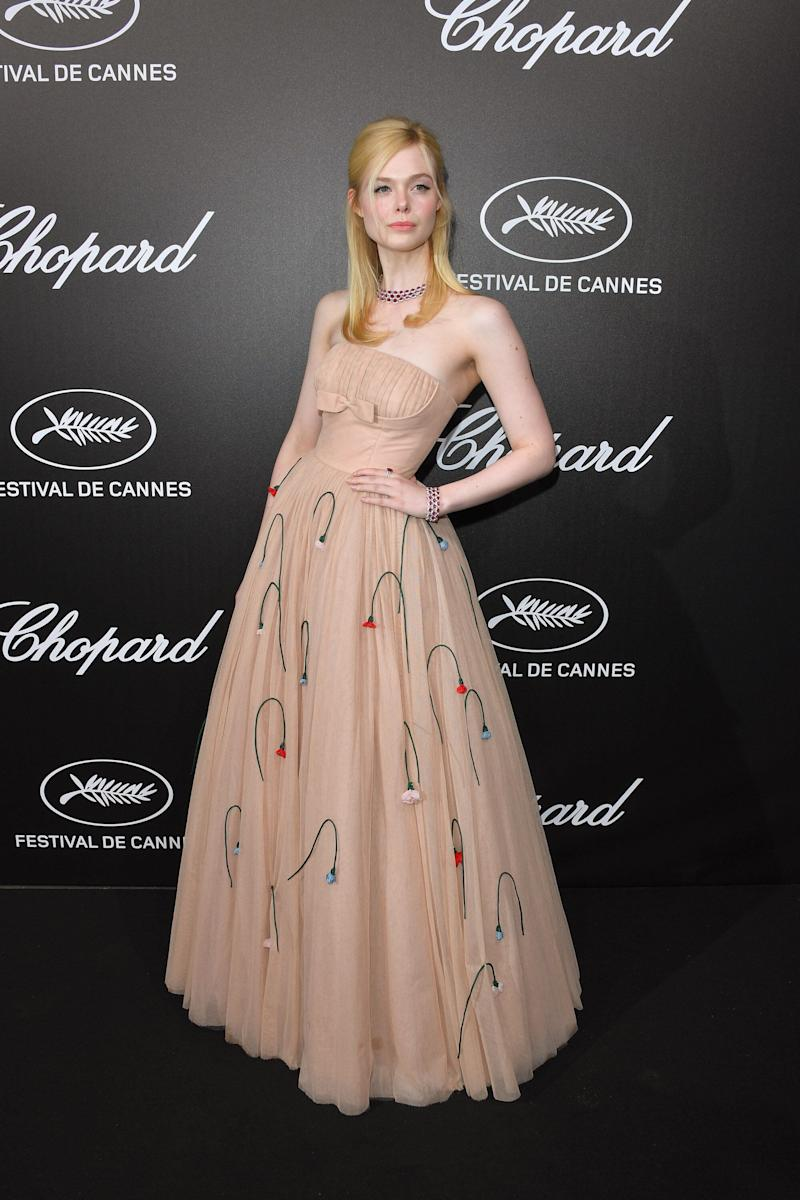 Elle Fanning wore a cold-shoulder corseted dress by Prada at the Chopard Trophy bash [Photo: Getty]